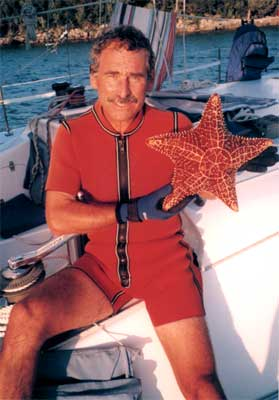 Tom holds starfish